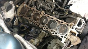 With the coolant removed you can see some carbon buildup that should be cleaned along with the block mating surface.